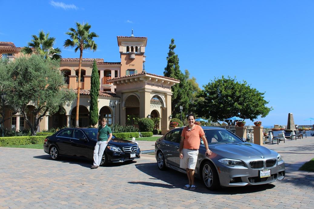 Vardan and Sasha next to their cars